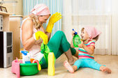 Happy mother with kid cleaning room and having fun — Stok fotoğraf