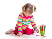 Child drawing with colorful pencils — Stock fotografie