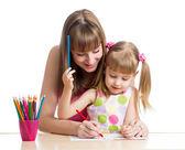 Madre y su niño niña lápiz junto — Foto de Stock
