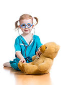 Kid playing doctor with toy — Stock Photo