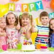 Children celebrating birthday party — Stok fotoğraf