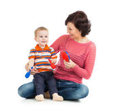 Mother and baby boy play with musical toys — Stock Photo