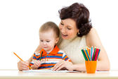 Mother and her child pencil together — Foto de Stock