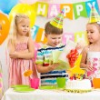Happy kids celebrating birthday holiday — Stok fotoğraf