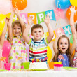 Happy kids celebrating birthday holiday — Stock Photo #33470057