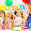 Foto Stock: Group of kids at birthday party