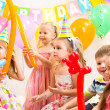 Kids group and clown on birthday party — Stock Photo #33470069