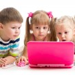 Group of kids friends looking at the laptop — Stock Photo