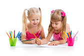 Two girls drawing with color pencils together over white backgro — Stock Photo