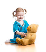 Child playing doctor with toy — Stock Photo