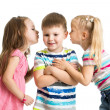 Kids girls sharing a secret with boy isolated — Stock Photo #33698721