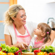 Mom and kid preparing healthy food — Stock Photo #34057423