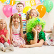 Jolly kids group and clown on birthday party — Stock Photo #34057565