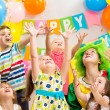 Jolly kids group with clown celebrating birthday party — Stock Photo #34057567