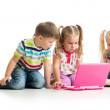 Group of kids friends working at the laptop — Stock Photo #34057623
