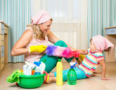 Mother with kid cleaning room and having fun — Stock Photo