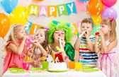Kids and clown at birthday party — Stock Photo