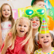 Jolly kids group and clown on birthday party — Stock Photo