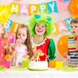 Children and clown at birthday party — Stock Photo
