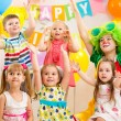 Jolly kids group and clown on birthday party — Stockfoto