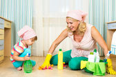 Mother and kid cleaning room — Stock Photo