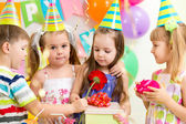 Pretty children with gifts on birthday party — Stock Photo