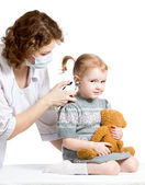 Doctor measuring temperature kid girl isolated — Stock Photo
