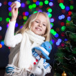 Child girl at Christmas tree — Stok fotoğraf