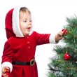 Kid girl decorating Christmas tree — Stock Photo