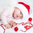 Sleeping baby girl Santa Claus — Stock Photo
