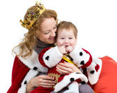 Mother and her son in suit of Christmas king isolated on white — Φωτογραφία Αρχείου