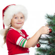 Pretty kid girl decorating Christmas tree isolated on white — Stock Photo