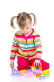 Kid girl playing with toys — Стоковое фото