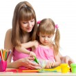 Mother and child draw and cut together — Stock Photo #34635559
