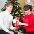 Happy couple opening gift — Stock Photo
