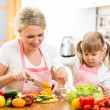 Mom and kid girl preparing healthy food — Stock Photo