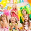 Jolly kids group and clown on birthday party — Stok fotoğraf