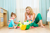 Mother and her daughter ready to room cleaning — Stock Photo