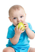 Baby boy eating green apple — Stock Photo