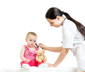 Doctor measuring temperature baby girl — Stock Photo