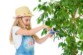 Gardener kid caring at tree — Stock Photo