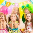 Jolly children group and clown on birthday party — Стоковое фото