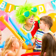 Kids group and clown celebrating birthday party — Stok fotoğraf