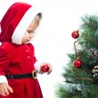 Baby girl decorating Christmas tree — Foto Stock