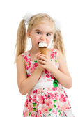 Child girl eating ice cream in studio isolated — Stock Photo