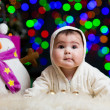 Smiling baby girl over Christmas background — Foto Stock