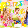 Happy children celebrating birthday holiday — Foto Stock