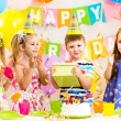 Happy children celebrating birthday holiday — Stok fotoğraf