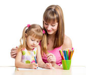 Mother and her child girl pencil together — ストック写真