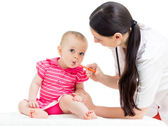 Doctor giving drug to baby girl — Stock Photo